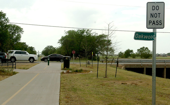 Traffic passses the west end of the Enid Trails on Oakwood Road Tuesday, May 6, 2014. Commissioners for the City of Enid are considering the expansion of the Enid Trails near Oakwood Road and on Rupe near Meadowlake Park. (Staff Photo by BONNIE VCULEK)