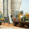 H & J Services, Inc. employees use two enormous cranes as they install the new grain belt leg at the Bison Coop Friday, May 16, 2014. The $500,000 expansion will allow area farmers to deliver loads of wheat and canola simultaneously. (Staff Photo by BONNIE VCULEK)