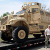 Lt. Gary Fuxa walks near the Enid Police Department's Army Surplus armored personnel carrier Tuesday, May 20, 2014. Lt. Fuxa was instrumental in obtaining the vehicle for the Enid Police Department through a grant request. The only cost to the department was the $2500 delivery fee. (Staff Photo by BONNIE VCULEK)