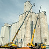 H & J Services, Inc. employees install a new grain belt leg extension at the Bison Coop Friday, May 16, 2014. The $500,000 expansion will allow area farmers to deliver loads of wheat and canola simultaneously. (Staff Photo by BONNIE VCULEK)