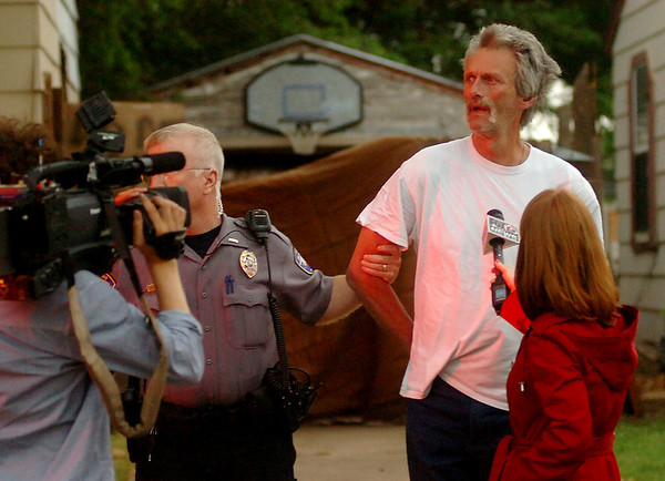 Fox 25 News interviews Jack Roland after his arrest at an Enid residence during a large-scale drug sweep Thursday, May 8, 2014. (Staff Photo by BONNIE VCULEK)