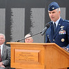 Col. John J. Menozzi (right), United States Air Force at Vance Air Force Base, announces the names that were posted on the Vietnam Memorial Wall during a special ceremony at Enid Woodring Regional Airport Friday, May 16, 2014. (Staff Photo by BONNIE VCULEK)