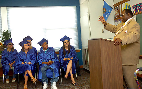 Carver Adult Education Center director, Clayton Nolen, gestures as he talks about the seniors during a recognition ceremony Tuesday. (Staff Photo by BILLY HEFTON)