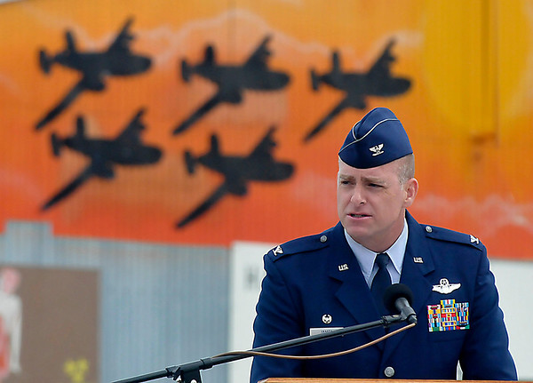 Col. Darren James, Wing Commander Vance AIr Base addresses the audience during the Woodring Wall of Honor Memorial Day ceremonies Monday. (Staff Photo by BILLY HEFTON)