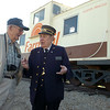 Watermelon Campbell (right), a Frisco Line Conductor and curator of the Railroad Museum of Oklahoma in Enid, visits with Bob Krieg before more than 180 individuals board the train for the 75th annual Rattlesnake Hunt in Okeene Saturday, May 3, 2014. Watermelon has been aboard trains over 74 years. (Staff Photo by BONNIE VCULEK)