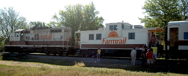 The last guests arrive and board the Farmrail Washita Princess before the train departs Enid for the 75th annual Okeene Rattlesnake Hunt Saturday, May 3, 2014. The Railroad Museum of Oklahoma in Enid sponsors the event each year. (Staff Photo by BONNIE VCULEK)