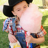 Gabe Sebranek munches on popcorn and cotton candy during the Frontier Festival Town Social & Dance at the Cherokee Strip Regional Heritage Center's Humphrey Heritage Village Saturday, May 17, 2014. (Staff Photo by BONNIE VCULEK)