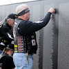 Vietnam Veterans post 21 additional names on the Vietnam Memorial Wall at Enid Woodring Regional Airport during a special ceremony Friday, May 16, 2014. (Staff Photo by BONNIE VCULEK)