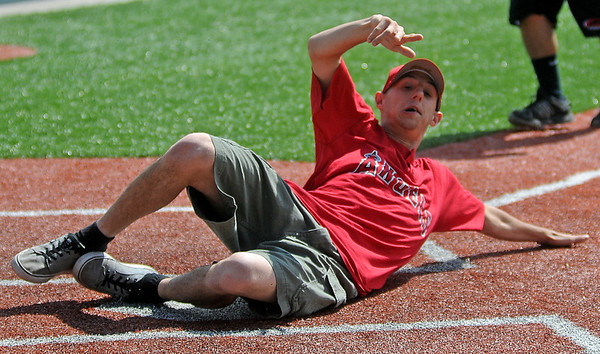 Angels' Jamie Morgan slides home during the Miracle League game against the Orioles at AMBUCS ABC Park Saturday, May 31, 2014. (Staff Photo by BONNIE VCULEK)