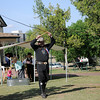 Pawnee Bill performs his double whip act during the Frontier Festival Town Social & Dance at the Cherokee Strip Regional Heritage Center's Humphrey Heritage Village Saturday, May 17, 2014. (Staff Photo by BONNIE VCULEK)