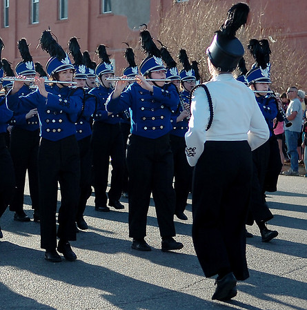 """The Enid High School Big Blue Band performs """"Oklahoma"""" as they pass the judges' stand during the 82nd annual Tri-State Parade Friday, May 2, 2014. (Staff Photo by BONNIE VCULEK)"""
