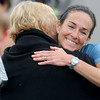 Nicki Klein (right) hugs Elaine Johns after winning the Red Dirt Run of Honor half marathon at Enid Woodring Regional Airport Saturday, May 24, 2014. (Staff Photo by BONNIE VCULEK)