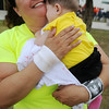 Susie Hallett hugs her niece, Gillian Ramos, after Hallett ran her first 5K in honor of her father, Pete Ramos Sr. during the Red Dirt Run of Honor at Enid Woodring Regional Airport Saturday, May 24, 2014. (Staff Photo by BONNIE VCULEK)