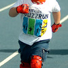 Bradley Kawcak sports Lightning McQueen gear as he burns up the track during the 5th annual Be Fit Kids Buzz Run at Enid High School Saturday, May 17, 2014. (Staff Photo by BONNIE VCULEK)