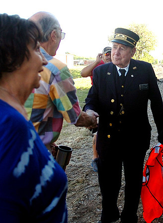 Watermelon Campbell (right) greets guests as they arrive for the Farmrail Train trip from Splashzone in Enid to Okeene Saturday, May 3, 2014. More than 180 purchased tickets for the one day excursion to the 75th annual Okeene Rattlesnack Hunt. Proceeds from the event support the Railroad Museum of Oklahoma in Enid. (Staff Photo by BONNIE VCULEK)
