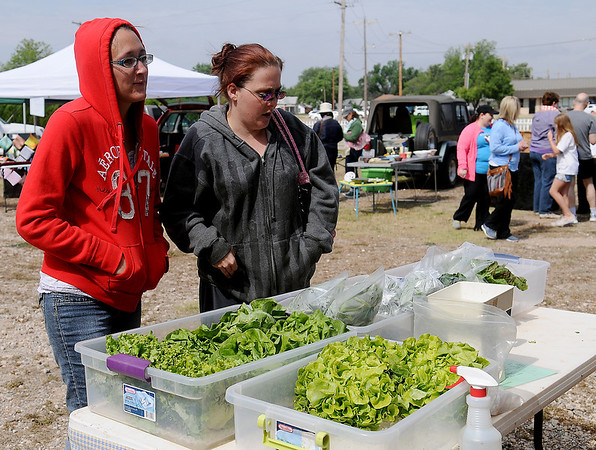 Customers shop at Enid Farmers Market Saturday, May 17, 2014. (Staff Photo by BONNIE VCULEK)