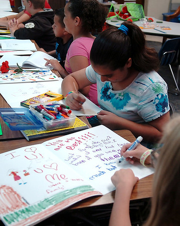 Fourth grade students at Taft Elementary School design large Mother's Day cards Friday, May 9, 2014. (Staff Photo by BONNIE VCULEK)