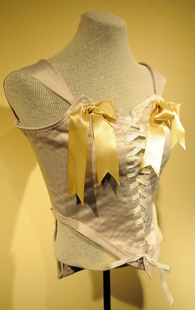 """The Cherokee Strip Regional Heritage Center's newest traveling exhibit, """"Bound to Please,"""" featuring traditional corsets from the 1800s and wearable ceramic corsets designed by Nicole Moan, opens to the public Wednesday, May 28, 2014. (Staff Photo by BONNIE VCULEK)"""