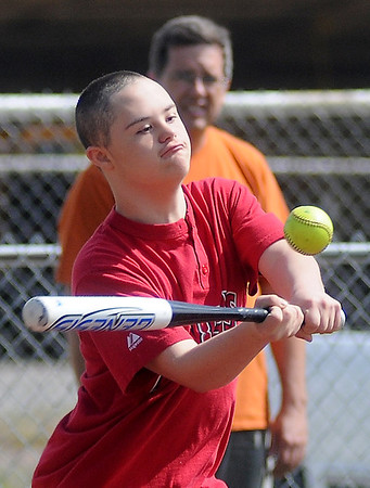 Angels' Hunter Melvin clears the bases with a hit into right field during the Miracle League games at the AMBUCS ABC Park Saturday,. May 31, 2014. (Staff Photo by BONNIE VCULEK)