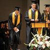 Kevin Kim (left) bows to the audience as Kim, Kevin Suderman and Katie Irwin complete the Class of 2014 reading during Oklahoma Bible Academy's commencement exercises Friday, May 23, 2014. (Staff Photo by BONNIE VCULEK)