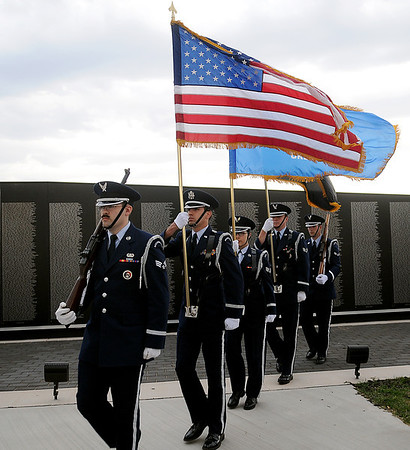The Vance Honor Guard presents the colors during the Vietnam Memorial Wall Name Placement Ceremony at Enid Woodring Regional Airport Friday, May 16, 2014. (Staff Photo by BONNIE VCULEK)