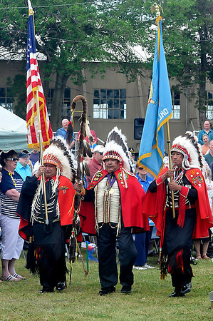 Members of the Kiowa Black Leggins Honor Society present the colors during the Woodring Wall of Honor Memorial Day ceremonies Monday. (Staff Photo by BILLY HEFTON)