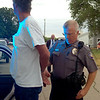 Enid Police Lt. Eric Holtzclaw arrests Jack Roland during the large-scale drug sweep by the Oklahoma Bureau of Narcotics, Oklahoma Highway Patrol, Enid Police Department, Garfield County Sheriff Department and other law enforcement agencies across the state. (Staff Photo by BONNIE VCULEK)