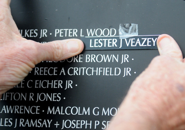 Ken Parker posts the name of his half-brother, Marine Lester J. Veazey, on the Vietnam Memorial Wall during a special ceremony at Enid Woodring Regional Airport Friday, May 16, 2014. Veazey, from Enid, was shot by small arms fire near Quang Tri Province, South Vietnam. He survived the wound, but was confined to his wheelchair until his death on June 6, 1977.  (Staff Photo by BONNIE VCULEK)