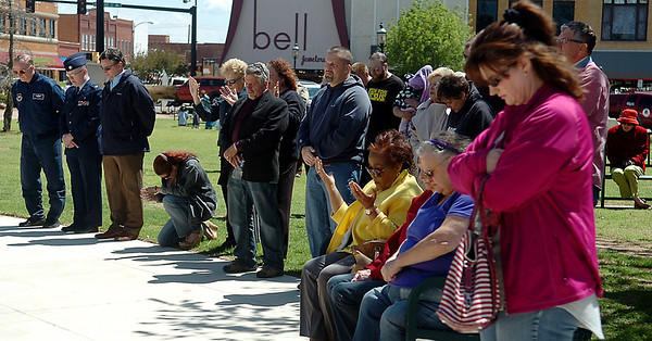 A woman kneels among others during the National Day of Prayer service on the Garfield County Courthouse lawn Thursday, May 1, 2014. (Staff Photo by BONNIE VCULEK)