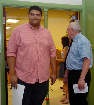 Alvin Jones (left) processes past Jarry Hillman, Lincoln Academy principal, as Jones enters the Emerson Middle School auditorium for Senior Appreciation Night Thursday, May 15, 2014. Jones, who spoke during the evening, was among 85 Lincoln Survivors honored. (Staff Photo by BONNIE VCULEK)
