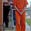 Individuals arrested during a large-scale drug sweep are transported to the Garfield County Detention Center after processing at the Enid Police Department Thursday, May 8, 2014. (Staff Photo by BONNIE VCULEK)