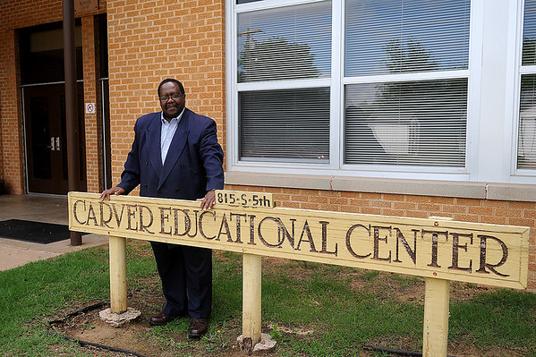 Clayton Nolen stands near the entrance of Carver Educational Center  Friday, May 30, 2014. Nolen retired after 41 years with Enid Public Schools in May. (Staff Photo by BONNIE VCULEK)