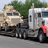 Enid Police officers escort an Army surplus armored personnel carrier to the EPD Police Department Tuesday, May 20, 2014. The vehicle was awarded to the department after a 2-year grant writing process by EPD Lt.  Gary Fuxa. (Staff Photo by BONNIE VCULEK)