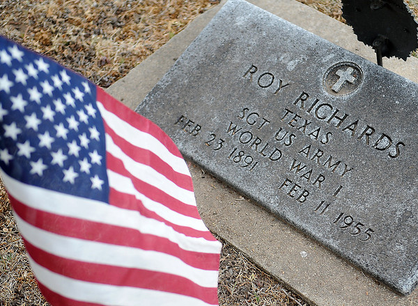 A United States flag honors Sgt. Roy Richards, U.S. Army veteran who served during World War I, at the Enid Cemetery Friday, May 23, 2014. (Staff Photo by BONNIE VCULEK)