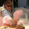 Joan Galbraith makes cotton candy at the Frontier Festival Saturday, May 17, 2014. (Staff Photo by BONNIE VCULEK)