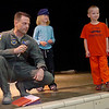 Lt. Col. Kevin Kohl, Grace and Austin thank the Chisholm Elementary School students and staff for all of the cards and letters during Kohl's deployment to Iraq during an assembly Friday, May 2, 2014. (Staff Photo by BONNIE VCULEK)