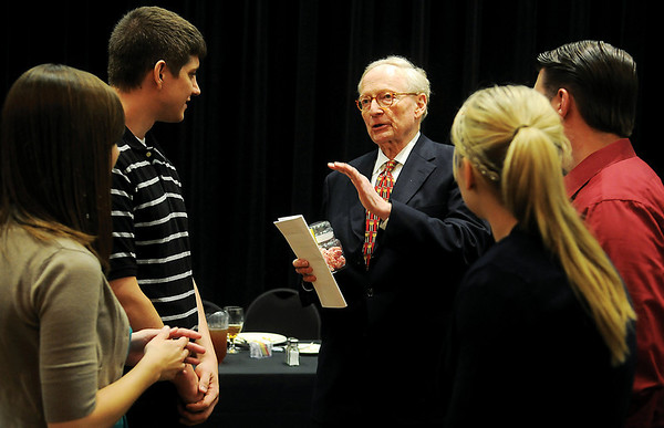 Stephen Jones (center), from Jones, Otjen, Davis & Nixon, visits with his staff after his address at the Enid Noon AMBUCS in the Gantz Center at Northern Oklahoma College Enid Friday, May 30, 2014. In 1997, Stephen Jones was the lead defense attorney for Timothy McVeigh, who was on trial for the 1995 Oklahoma City bombing. While defending McVeigh, Jones traveled to other countries in search of evidence that McVeigh did not act alone in the bombing. McVeigh was convicted on all 11 counts regarding his actions in the Oklahoma City bombing and executed in 2001. (Staff Photo by BONNIE VCULEK)