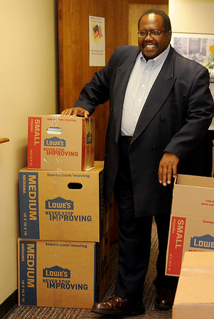 Clayton Nolen smiles as he prepares Carver Educational Center files for transfer to Lincoln Academy Friday, May 30, 2014. Nolen retired after 41 years with Enid Public Schools in May. (Staff Photo by BONNIE VCULEK)