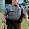 Enid Police Lt. Eric Holtzclaw participates in a large-scale drug sweep in Enid Thursday, May 8, 2014. (Staff Photo by BONNIE VCULEK)