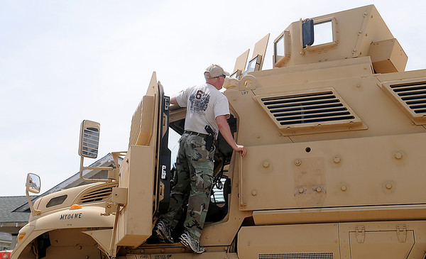 Lt. Gary Fuxa, with the Enid Police Department, examines EPD's Army surplus armored personnel carrier Tuesday, May 20, 2014. The SWAT vehicle, transported by J & B Heavy Haul from Oklahoma City, was awarded to the Enid Police Department after a two-year grant process was completed by Lt. Gary Fuxa. (Staff Photo by BONNIE VCULEK)