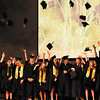 OBA seniors toss their caps into the air following graduation Friday May 27, 2016. (Billy Hefton / Enid News & Eagle)