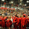 Confetti and silly string fill the air at the end of the Chisholm High School graduation Monday May 16, 2016. (Billy Hefton / Enid News & Eagle)