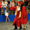 Ryan Tom and Alaina West take a selfie during the processional at the Chisholm High School graduation Monday May 16, 2016. (Billy Hefton / Enid News & Eagle)