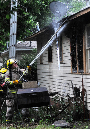 Enid firefighters work a structure fire at 2310 E Court Thursday May 19, 2016. (Billy Hefton / Enid News & Eagle)