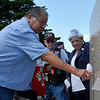 Tony Yost points to his son's name, Anthony Yost, on the Woodring Wall of Honor during Memorial Day services Monday May 30, 2016. (Billy Hefton / Enid News & Eagle)