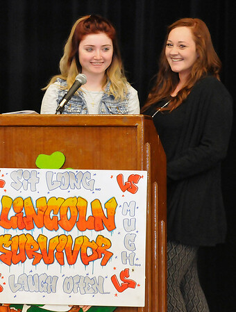Lincoln Academy seniors, Grace Ballard and Cynthia Diaz, laugh while giving their speeches during Lincoln Academy Senior Appreciation Night Tuesday May 17, 2016. (Billy Hefton / Enid News & Eagle)