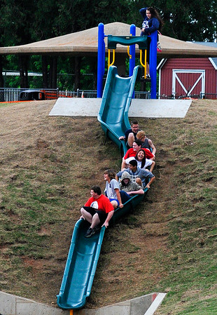 A group of students have fun on the big slide at Meadowloake Park Monday May 23, 2016. (Billy Hefton / Enid News & Eagle)