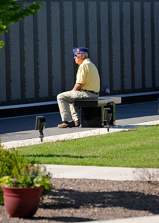 A man sits alone prior to Memorial Day services at the Woodring Wall of Honor Monday May 30, 2016. (Billy Hefton / Enid News & Eagle)
