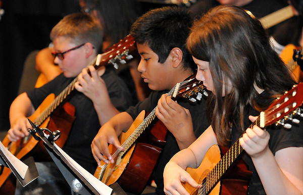Students from Longfellow Middle School perform during the Lead Guitar Enid of Year Concert Monday May 2, 2016 at Emerson Middle School. (Billy Hefton / Enid News & Eagle)