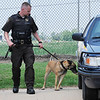 Garfield County deputy Jason Reim and his dog GeGe take part in National Police Canine Association certification Wednesday May 25, 2016 at the Garfield County Sheriff Department. (Billy Hefton / Enid News & Eagle)